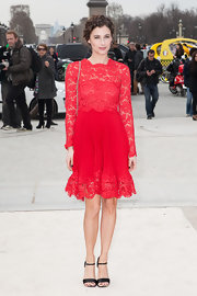 Melanie Bernier looked flirty and fun in a long-sleeved red lace dress.