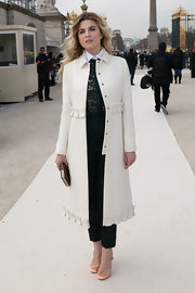Cecile Cassel looked feminine and chic in a wool coat with ruffled hem and waist.