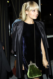 Nicole Richie arrived at II Sole wearing her hair in a chic ponytail with full bangs falling just below brow length. Her 'do is simple, clean, and classic with plenty of sleekness and shine.