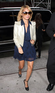 Nicole Richie paired her flouncy navy blue dress with a cropped leather jacket.