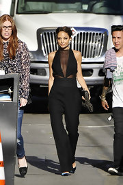 Nicole Richie may be known for her bohemian style, but this time the starlet chose a more sexy look with this sheer jumpsuit.