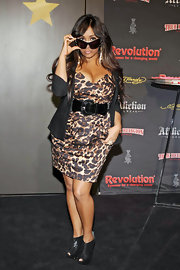 Snooki gets seductive in a wild leopard print dress with a deep sweetheart neckline.