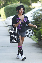 Nicole 'Snooki' Polizzi opted for a quirky street look with a high side ponytail, polka dot knee socks and a black-and-white Hello Kitty tote.