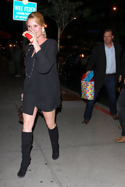 Nicolette Sheridan partied in black platform knee high boots.
