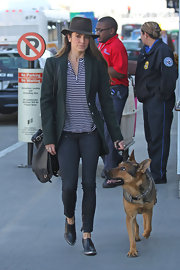 The only thing cuter than Nikki's ankle-zip skinnies? Her German Shepherd puppy!
