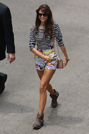 Nina Dobrev's black-and-white striped top may have looked simple, but from the back a vivid splash of floral peeked out!