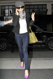 Nina Dobrev dressed up her skinny jeans with a pair of fuchsia suede pumps.