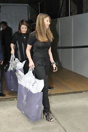 Nina Garcia finished off her simple ensemble in chic style with a pair of black cutout boots.