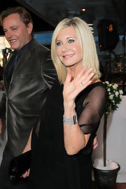 Olivia Newton-John adorned her wrist with a multi-strand silver bracelet at the premiere of 'A Few Best Men.'