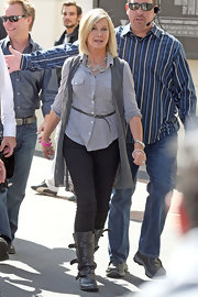 Olivia Newton-John appeared on 'Extra' wearing a button-down shirt, a vest, a pair of skinny jeans, and a pair of trendy boots.