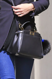 Olivia Palermo opted for this adorable black leather shoulder bag for her trip out to Brooklyn.