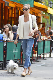 Olivia Palermo's crisp white jacket gave her look a light and summery feel.