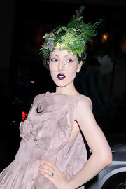 Michelle wears a green decorative hat with a veil to show her support of the Green Auction event in NYC.