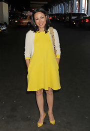Ann Curry attended the 2011 Fresh Air Fund Salute to American Heroes wearing a shift dress in a bold yellow hue.