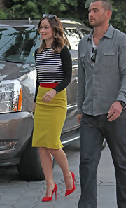 Olivia Wilde paired a black and white striped sweater with a classic pencil skirt for an interesting blend of classic and modern.