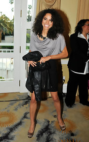Jurnee Smollett arrived at the Jenesse Silver Rose Awards wearing a shiny pair of gold satin pumps.