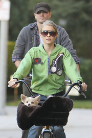 Kenzie protects her skin with oversized aviator shades while riding bikes with the fam.