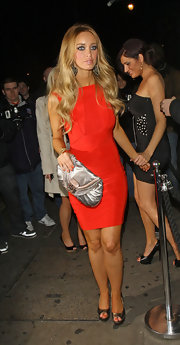Lauren Pope accented her bright red dress with a metallic silver clutch.