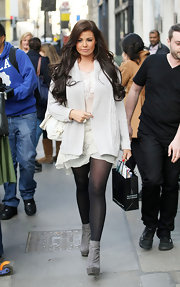 Jessica Wright left a salon in London wearing a pair of dove gray suede ankle boots.