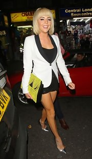 Lydia Rose Bright toned down the sexiness of her LBD with a stylish white blazer.