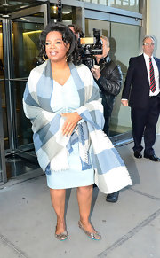 Oprah Winfrey bundled up in a checkered shawl as she arrived at the CBS Studios.