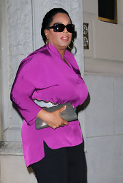 Oprah Winfrey looked sophisticated in a purple silk tunic while out on a dinner date.