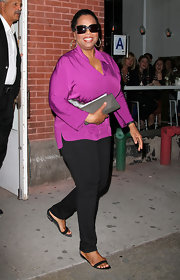 Oprah Winfrey accessorized with a simple gray envelope clutch for her dinner date with boyfriend Stedman Graham.