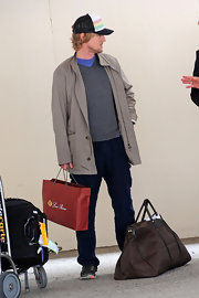 Owen Wilson opted for a zip-up trenchcoat for his travel look while leaving LAX.
