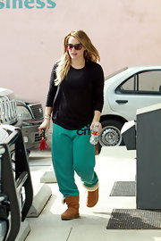 An expectant Hilary Duff looked cozy in a pair of turquoise sweats, sheepskin boots and a loose black top.