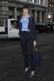 Erin O'Connor wore a dark navy blazer with a pink-lined collar over a blue button blouse during London Fashion Week.