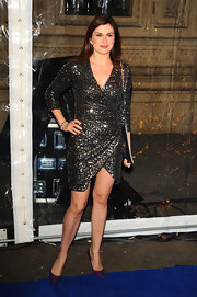 Amanda Lamb wore a gunmetal metallic faux-wrap dress for the 'Totem' show in London.
