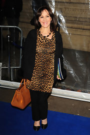 Arlene Phillips wore a leopard print dress over her pants for the 'Totem' show in London.