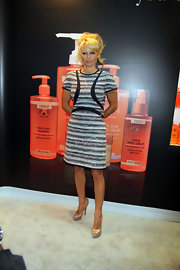 Pamela Anderson kept her look classic and sophisticated with this gray and black shift dress.