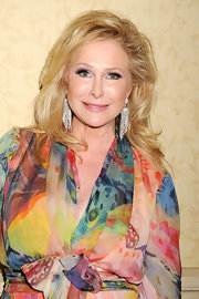 Kathy Hilton glammed it up with a pair of crystal chandelier earrings at the Oxygen Media Upfronts.