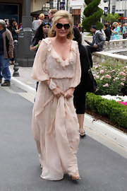 Kathy Hilton was boho-chic on 'Extra' in a ruffled nude maxi dress.