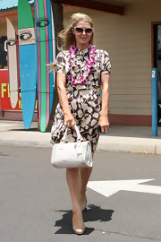 Paris Hilton chose this brown floral shirtdress for her tropical look while out in Hawaii.