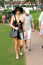 Paris sports JLo style with a black floppy hat and large sunglasses.