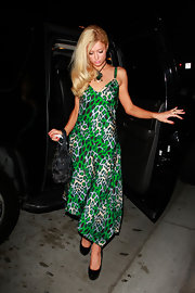 Paris donned a bright green animal-print dress while out at dinner in LA. She kept her accessories simple, with complementary black platform pumps.