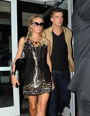 Paris brought on the sparkle in this sequin-adorned mini while leaving dinner with her beau.