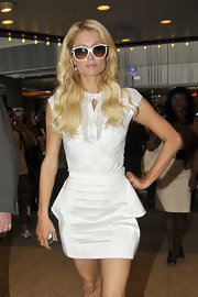 Paris Hilton made a stop at MTV studios in NYC to promote her new reality show, The World According to Paris, wearing crisp white sunglasses with posh gold trim.