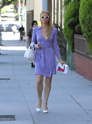 Paris opted for a stylish printed wrap dress in this bold purple color while out in Beverly Hills.