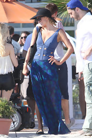 Paris Hilton chose a flowing blue, lace print maxi skirt for her beachy look while in Malibu.