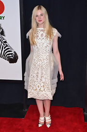 Elle Fanning matched the fashion-forward vibe of her dress with white pointy-toe mules.