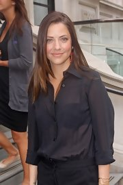 Julie Gonzalo sported a menswear-inspired look with this sheer black button-down during a trip to London.