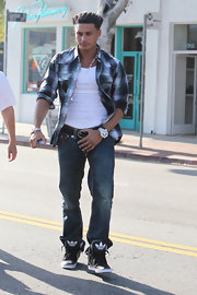 Paul D. hit Melrose for some retail therapy sporting top-stitched jeans tucked into black and white, lace-up sneakers.