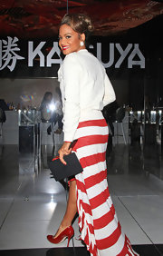 Christina Milian went out for dinner at Katsuya in Hollywood wearing a pair of red patent leather pumps.