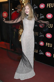 Arielle Dombasle was exuberant in this dramatic ensemble at the Paris premiere of 'Feu.'