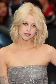 Peaches Geldof looked like a living doll at the 'Prometheus' premiere thanks to her girlish ringlets and porcelain foundation.