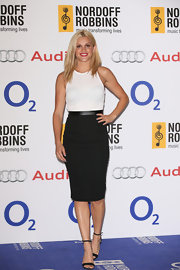 Ashley Roberts looked sleek as ever in this white and black cocktail dress.