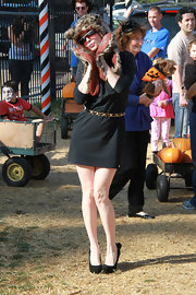 Phoebe Price went to the pumpkin patch in a black day dress with a chain belt.
